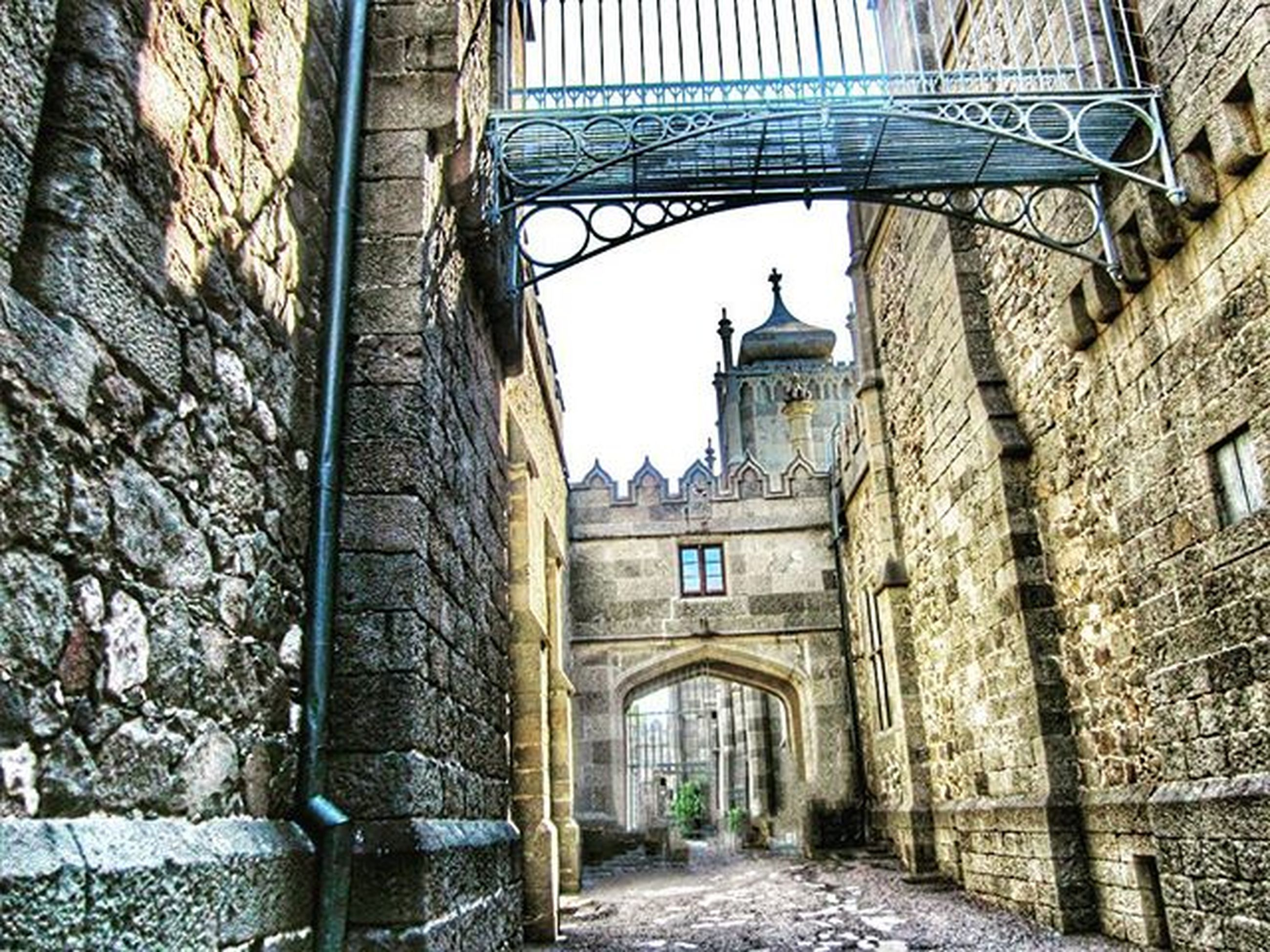 architecture, built structure, arch, building exterior, the way forward, history, archway, diminishing perspective, day, travel destinations, building, walkway, arched, old, religion, incidental people, historic, cobblestone, travel, low angle view