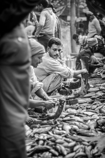 Adult Adults Only Army Blackandwhite Day Envy Fish Fish Market Fish Monger Men Only Men Outdoors People Sale Street Street Market Streetphotography Traditional Clothing Waiting
