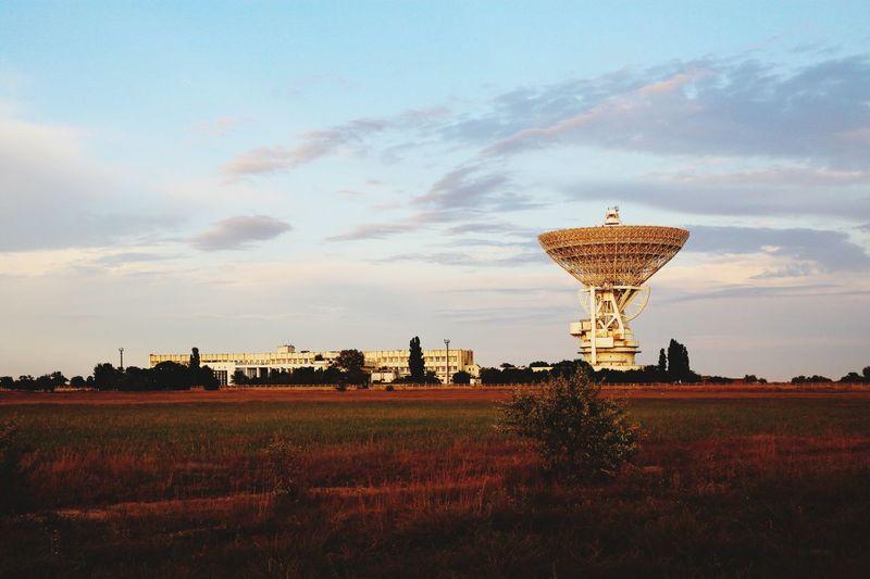 Satellite Dish On Field Against Sky