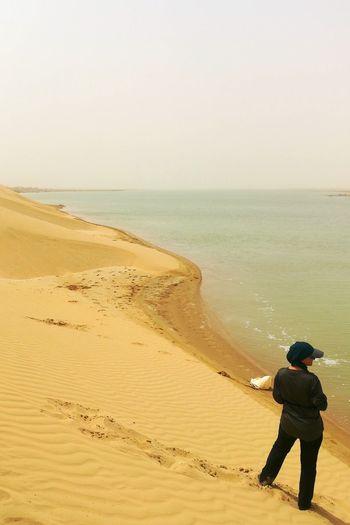 EyeEm Best Shots EyeEmNewHere EyeEm Selects Sand Dune Water Clear Sky Sea Full Length Beach Standing Sand Sunset Summer
