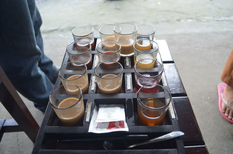 High Angle View Of Glasses Of Refreshments In Container