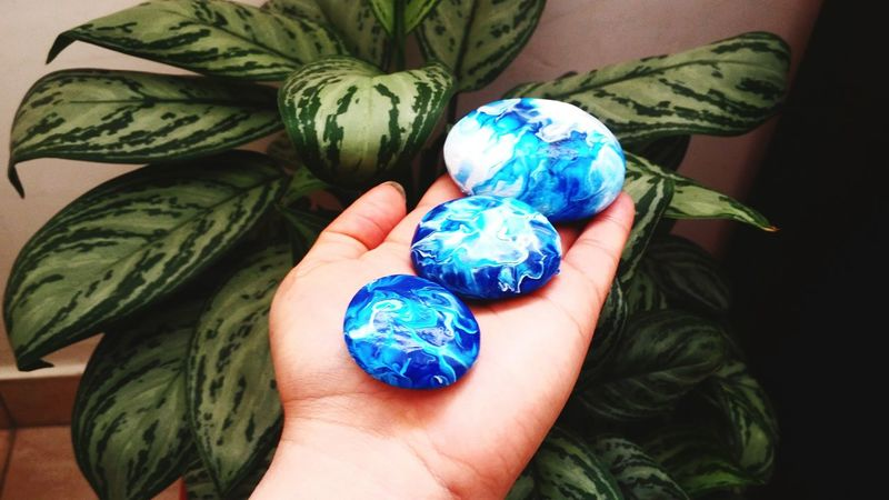 stones from ocean Zen Relaxation Creation EyeEm Selects Human Hand Hand Blue Human Body Part Holding One Person Green Color Art And Craft Creativity Personal Perspective Body Part Multi Colored Women