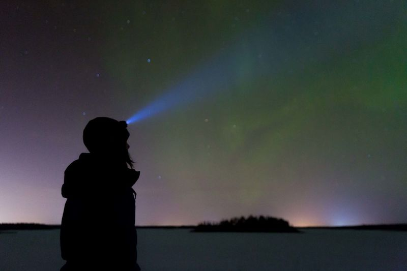 Exploring at night with a head light. Sighting the northern lights. Silhouette Night One Person Star - Space People Adult Standing Light Beam Flashlight Astronomy Nature Women Outdoors Scenics Exploring Night Photography Adventure Northern Lights Canada Canadian The Great Outdoors - 2017 EyeEm Awards