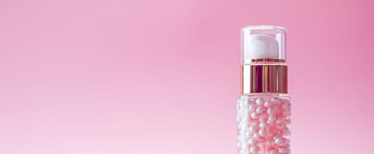 Close-up of bottle against pink background
