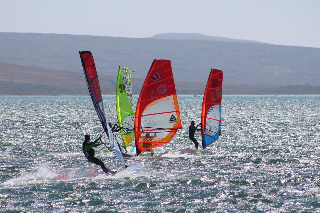 extreme sports, adventure, sport, leisure activity, real people, windsurfing, lifestyles, mountain, challenge, day, water, nature, skill, men, surfing, scenics, sea, risk, outdoors, aquatic sport, one person, vacations, sky, beauty in nature, people, adult, adults only