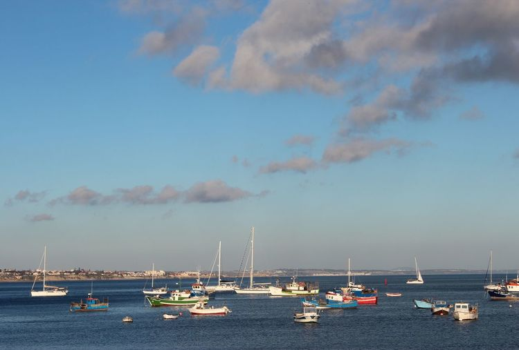 High Angle View Of Boats Moored In Harbor Against Sky During Sunset