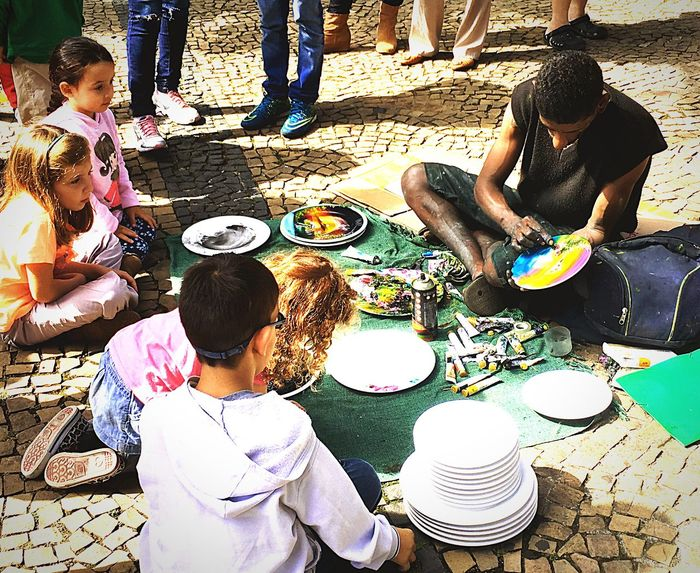 Artist producing and kids admiring Art Is Everywhere ArtWork Day High Angle View Artist Sitting Real People Childhood Leisure Activity Outdoors Lifestyles Human People Appreciation Sensitivity