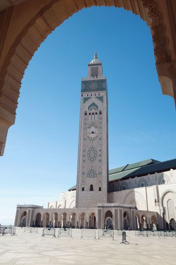 Moroccan Hassan Mosque 2 Hassan II Mosque Arch Architecture Built Structure Building Exterior Tower Clear Sky Blue City Architectural Feature Arched Tall - High Sky Day Outdoors Tall In Front Of Archway Façade Tourism Town Casablanca, Morocco
