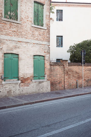 Architecture Building Building Exterior Built Structure City Day Door Empty Entrance House No People Outdoors Plant Residential District Road Sign Street Transportation Venice Wall Window