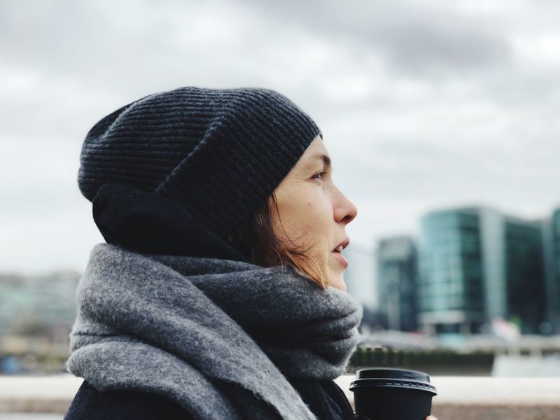 EyeEm Selects One Person Young Adult Headshot Side View Focus On Foreground Young Women Outdoors Real People Day Warm Clothing Sky One Young Woman Only Close-up City One Woman Only Adult Adults Only People Lifestyles