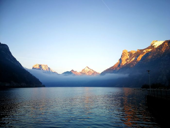 GOOD EVENING EyeEmNewHere Wintersun Austria Sun Lake Scatoelfen Water Colour Of Life Mountain EyeEm Selects Mountain Lake Water Outdoors Nature No People Scenics Landscape Tranquility Mountain Range Beauty In Nature Day Sky Sunset Idyllic Waterfront Tranquil Scene Clear Sky Blue