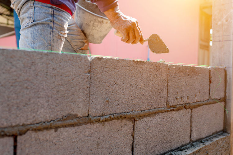 Man working on concrete wall