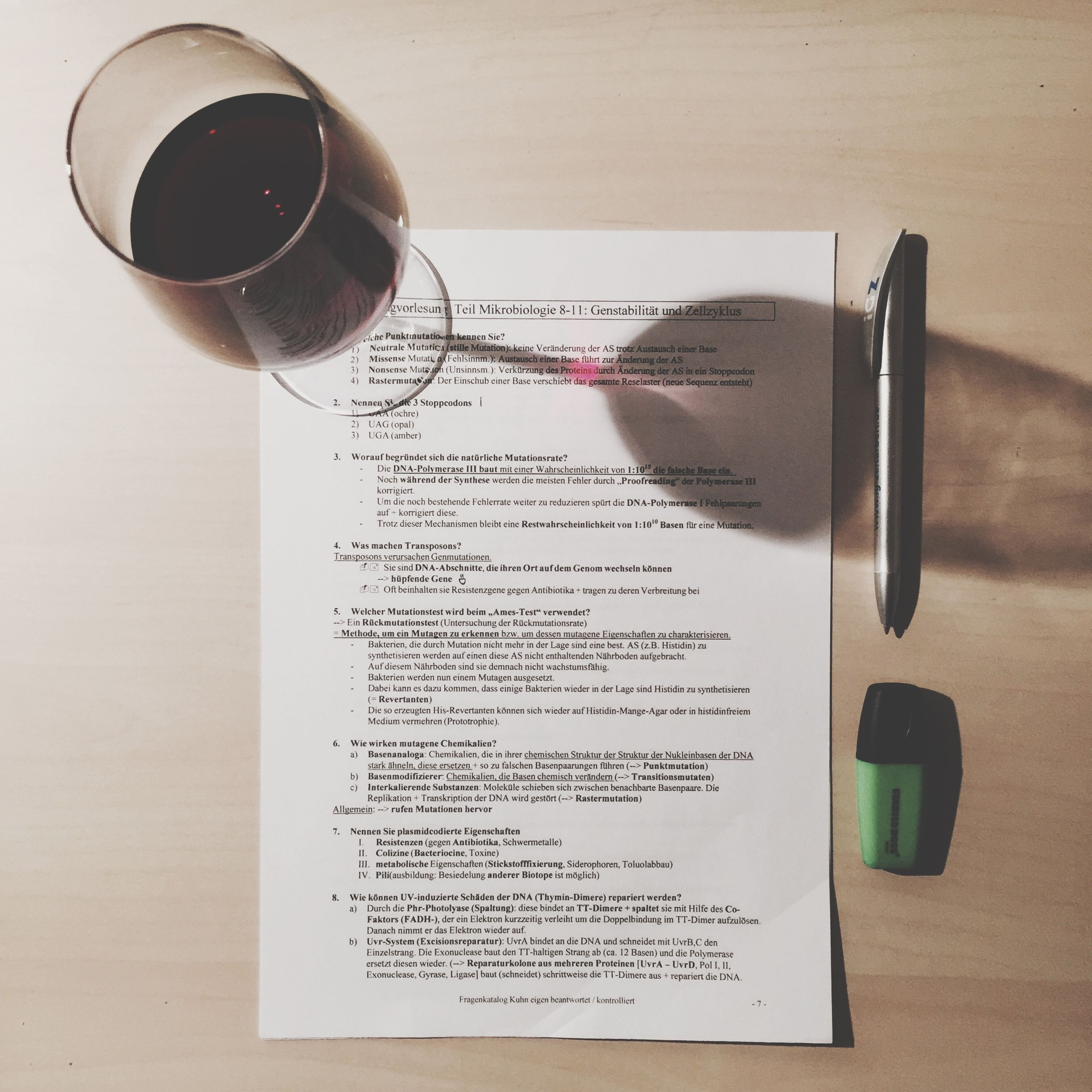indoors, still life, table, communication, text, paper, close-up, western script, pen, drink, technology, book, coffee cup, no people, education, high angle view, food and drink, refreshment, man made object, wood - material