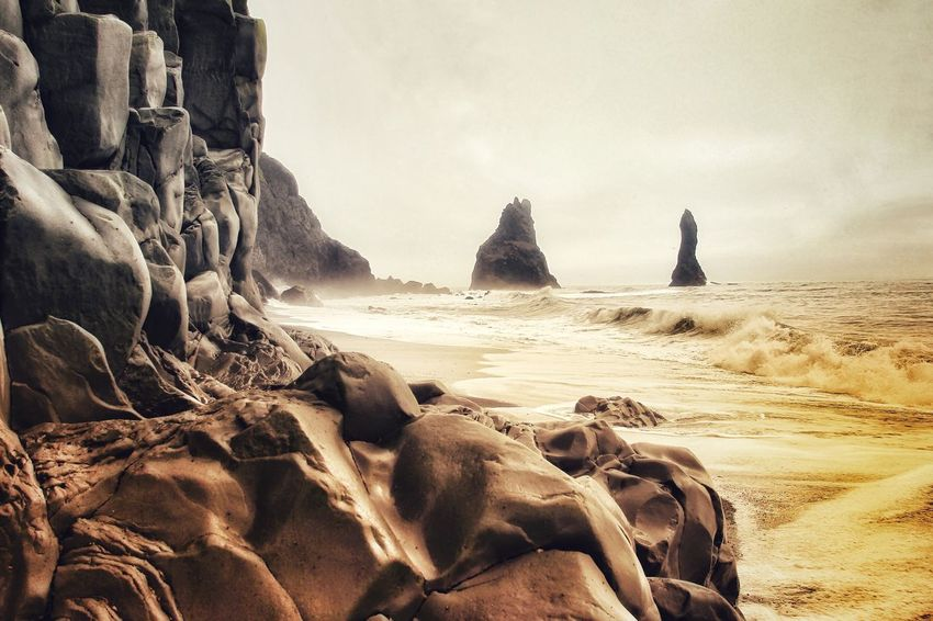 Reynisdrangar, Vik, Iceland Sea Rock - Object Rock Formation Horizon Over Water Nature Beauty In Nature Water No People Beach Sky Wave Sand Day Scenics Outdoors Reynisdrangar The Week On EyeEm Eye4photography  Travel Destinations Landscape Landscape_Collection EyeEm Nature Lover Rock Vik Vík í Mýrdal