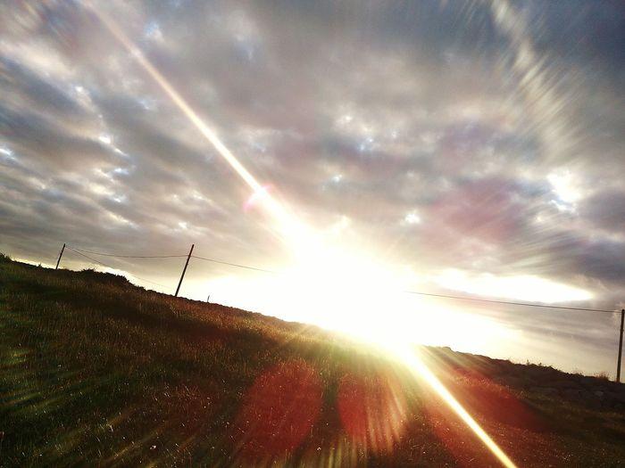 Irish daybreak Sunbeam Outdoors Grass Nature No People Beauty In Nature Sky Day Greatness Sun And Grass Sunrise Irish Summer, presso Ireland🍀