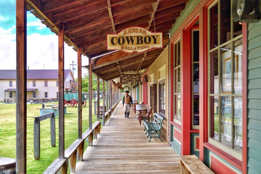 Old Buildings Cowboy Boot Hill Boot Hill In Dodge City, KS Dodge City Kansas Day Built Structure Walking Architecture Real People One Person Outdoors