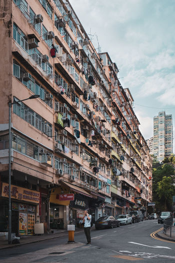 Old Buildings One Person One Man Only Architecture Kwun Tong EyeEm Best Shots EyeEm Selects EyeEm Gallery Building Exterior City Built Structure Sky Building Residential District Street Transportation Nature Cloud - Sky Road Day Outdoors Incidental People City Life Mode Of Transportation City Street Motor Vehicle Apartment Skyscraper The Architect - 2019 EyeEm Awards The Street Photographer - 2019 EyeEm Awards