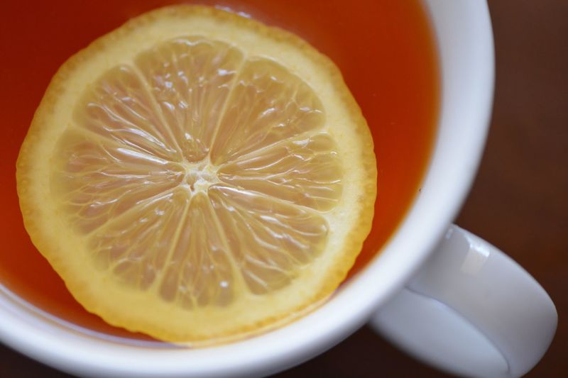 Directly above shot of tea with slice of lemon