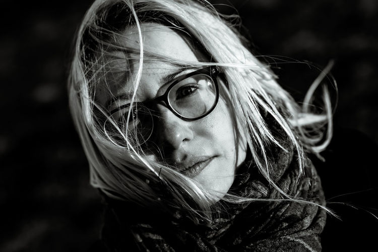 Headshot Portrait Women One Person Hair Young Adult Adult Close-up Looking At Camera Beautiful Woman Females Long Hair Glasses Young Women Eyeglasses  Blond Hair Beauty Looking Hairstyle Tousled Hair Contemplation Black Background Human Face Teenager Romantic