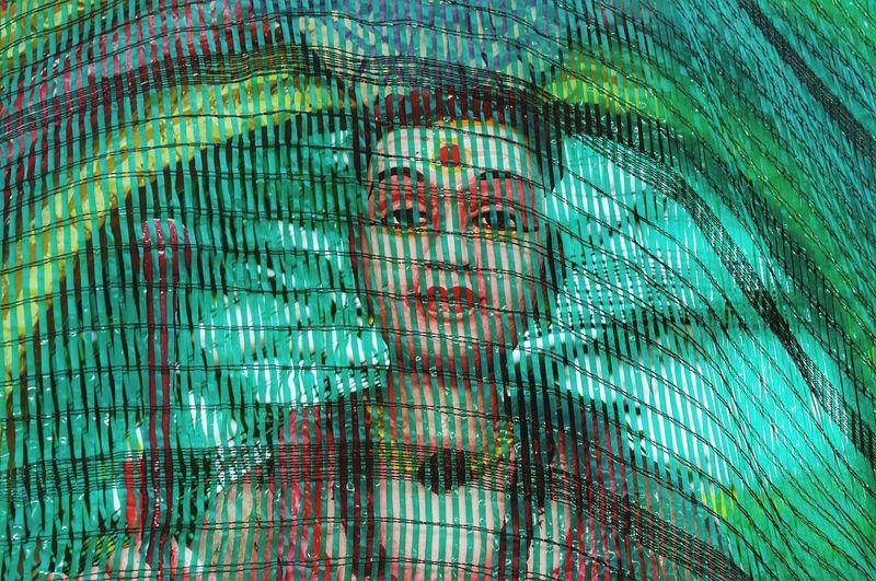 Digital composite image of woman seen through window