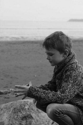Boy sitting at beach