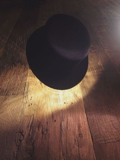 Close-up of lamp on hardwood floor at home