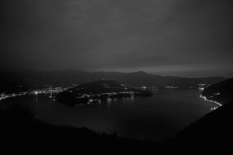Lake Iseo Water Sky Mountain Night Sea No People Illuminated Scenics - Nature Beauty In Nature Nature Architecture City Tranquility Tranquil Scene Mountain Range Land Cloud - Sky Building Exterior Outdoors Bay