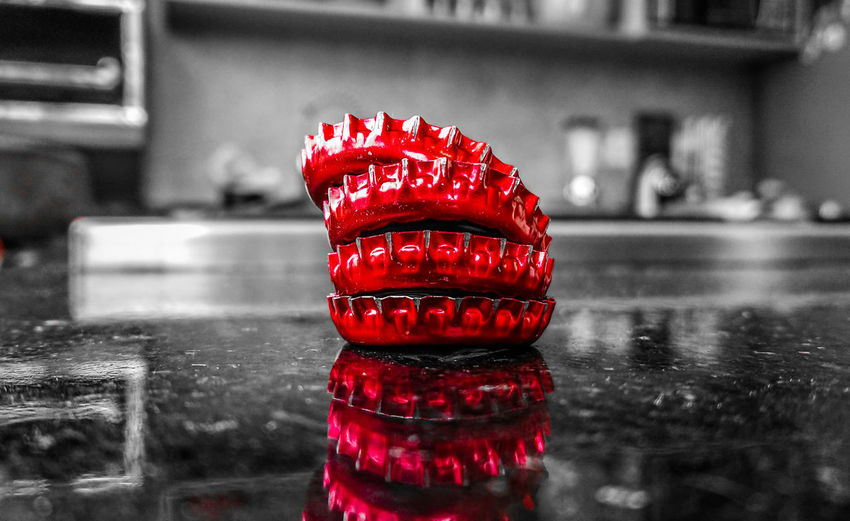 Stacked beer bottle caps Bottle Bottle Caps Bottle Caps Art Red Color Only Red Black And White Black And White Background One Color Beer Beer Bottle Caps Water Red City Close-up Bottle Cap