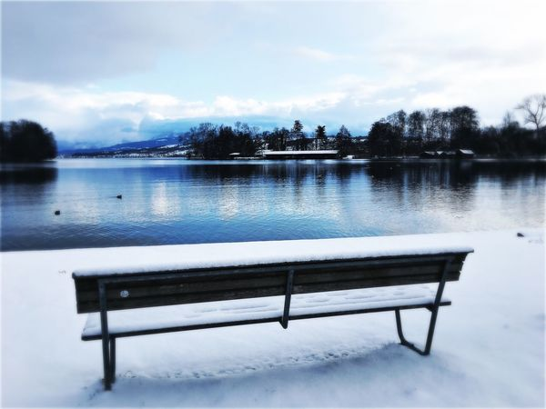 Water Bench Sky Lake Nature Snow No People Winter Day Outdoors Tree Scenics Cold Temperature Beauty In Nature