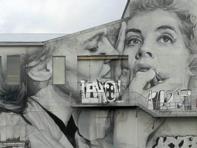 Streetphotography The Purist (no Edit, No Filter) Grey Sky Streetart Graffiti Destruction Façade City Life Portrait Young Women Business Occupation Business Finance And Industry Text Sky Close-up