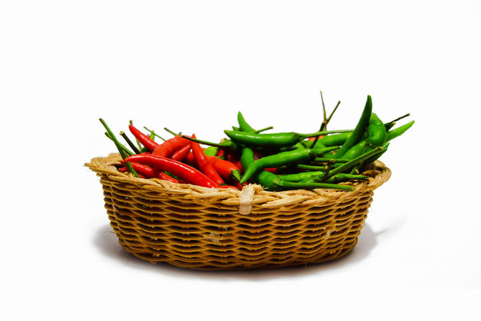 พริกบนตระกร้า พริก chilli Basket Broccoli Chilli Close-up Food Food And Drink Freshness Healthy Eating Multi Colored No People Scallion Still Life Studio Shot Vegetable White Background พริก