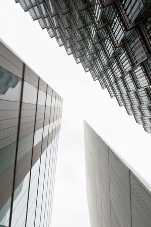 A photo looking up capturing three different buildings on an angle Architecture Architecture Art Building Exterior Built Structure Business Business Finance And Industry City Clear Sky Day England Gap London London Lifestyle Lookingup Low Angle View Modern No People Outdoors Sky Skyscraper Triangle