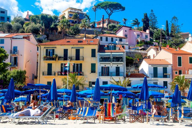 Holiday Beachphotography Blue Clear Sky Colorful Italian Beach Parasol Sunshine Vacation