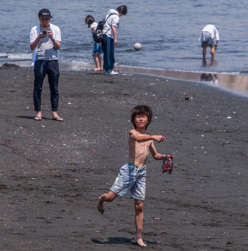 Full length of children on beach