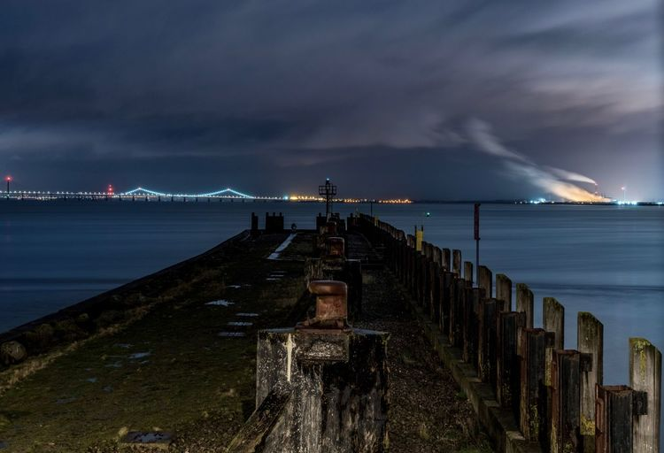 Water Cloud - Sky Sky Sea Architecture Nature Illuminated Night Built Structure Storm Beauty In Nature Beach Travel Destinations Power In Nature Transportation No People Building Exterior Pier Outdoors City