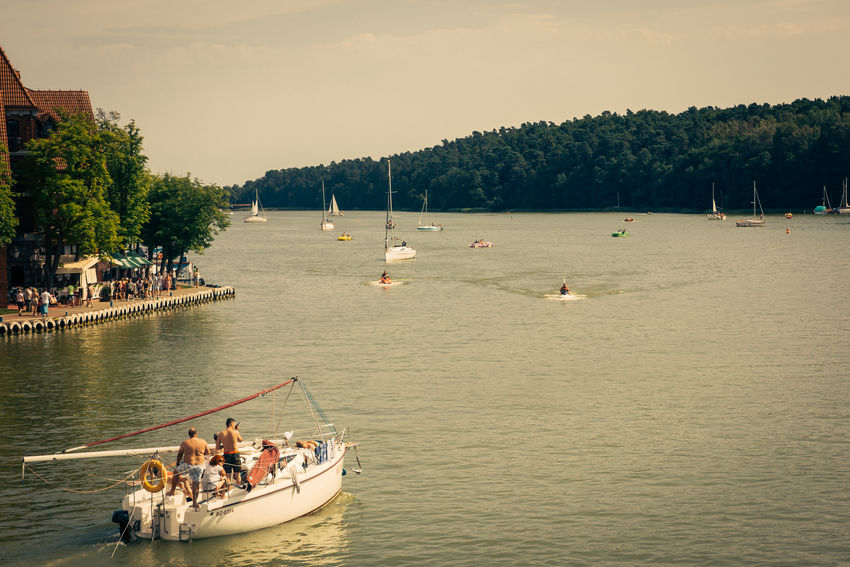 People sailing on a lake in Mikolajki, Poland. Boat Lake Mikołajki Nautical Vessel Poland Summer Transportation Vacation Water Waterfront