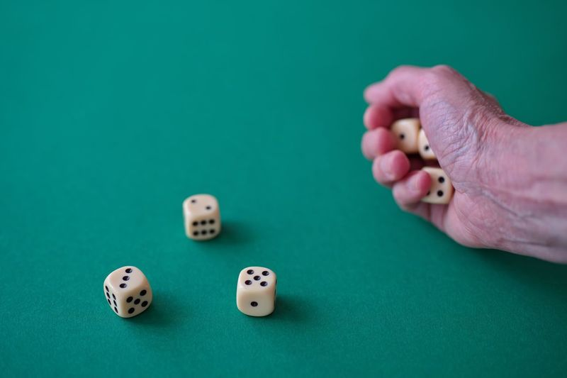 High angle view of playing on table against blue background