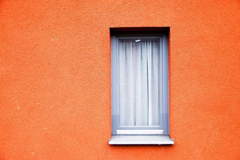 Exterior of orange building with window