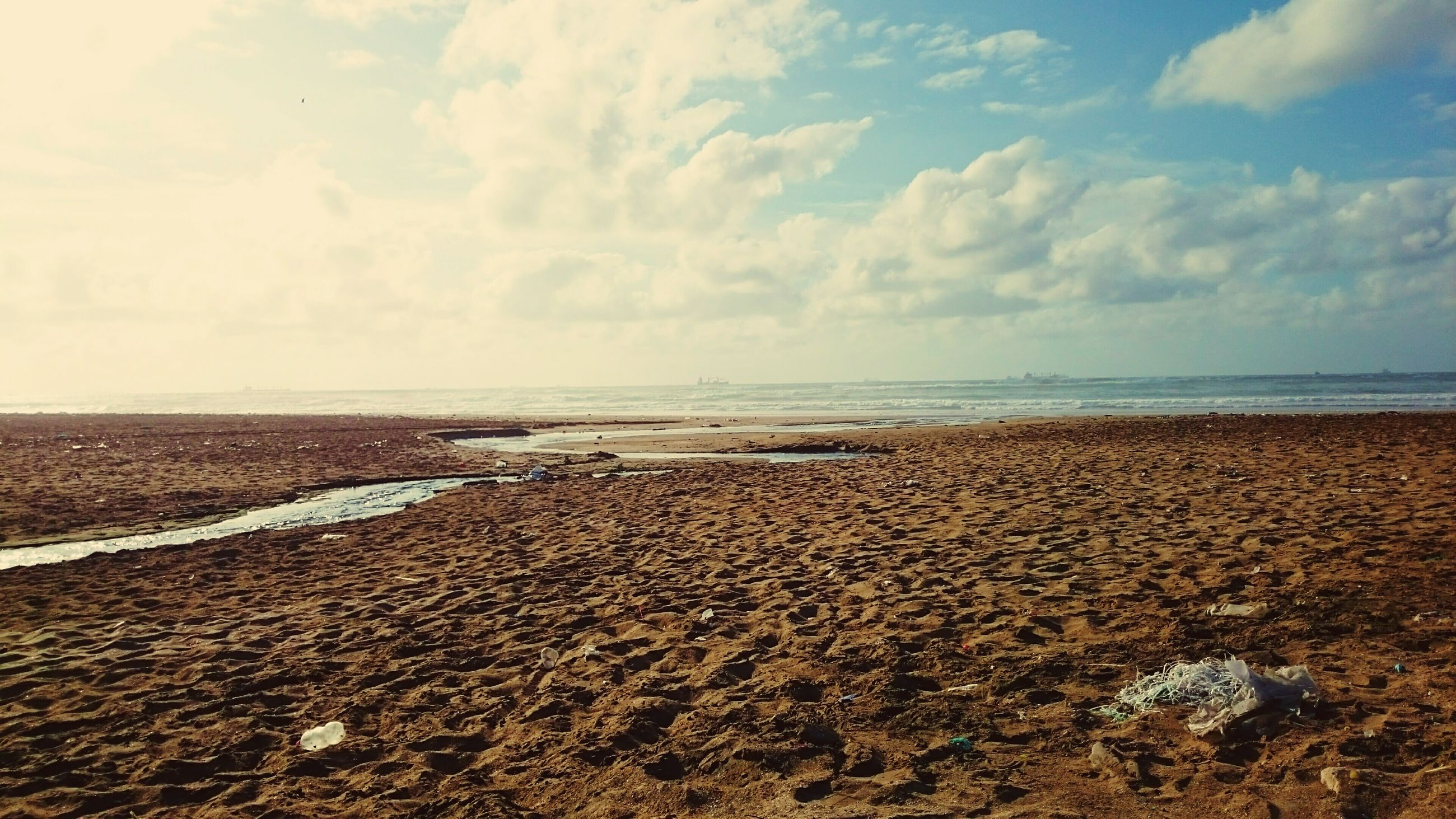 beach, sea, sand, shore, sky, nature, water, horizon over water, scenics, tranquility, tranquil scene, beauty in nature, outdoors, day, cloud - sky, no people, pebble beach