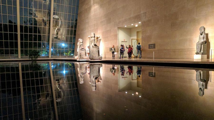 People walking in illuminated city