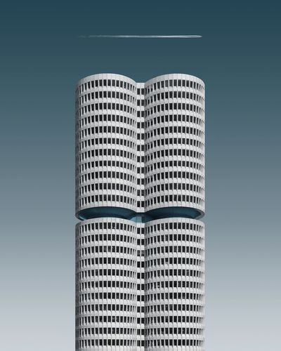 Digital composite image of building against blue sky