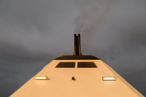 Close-up view of a chimney of a passanger ship Black Burn Chimey Close-up Cloud Copy Space Dark Directly Below Energy Ferry Journey Nautical Vessel Passenger Ship Pollution Scary Sea Sky Smog Smoke Tourist Toxic Substance Transportation Travel Vacations Water