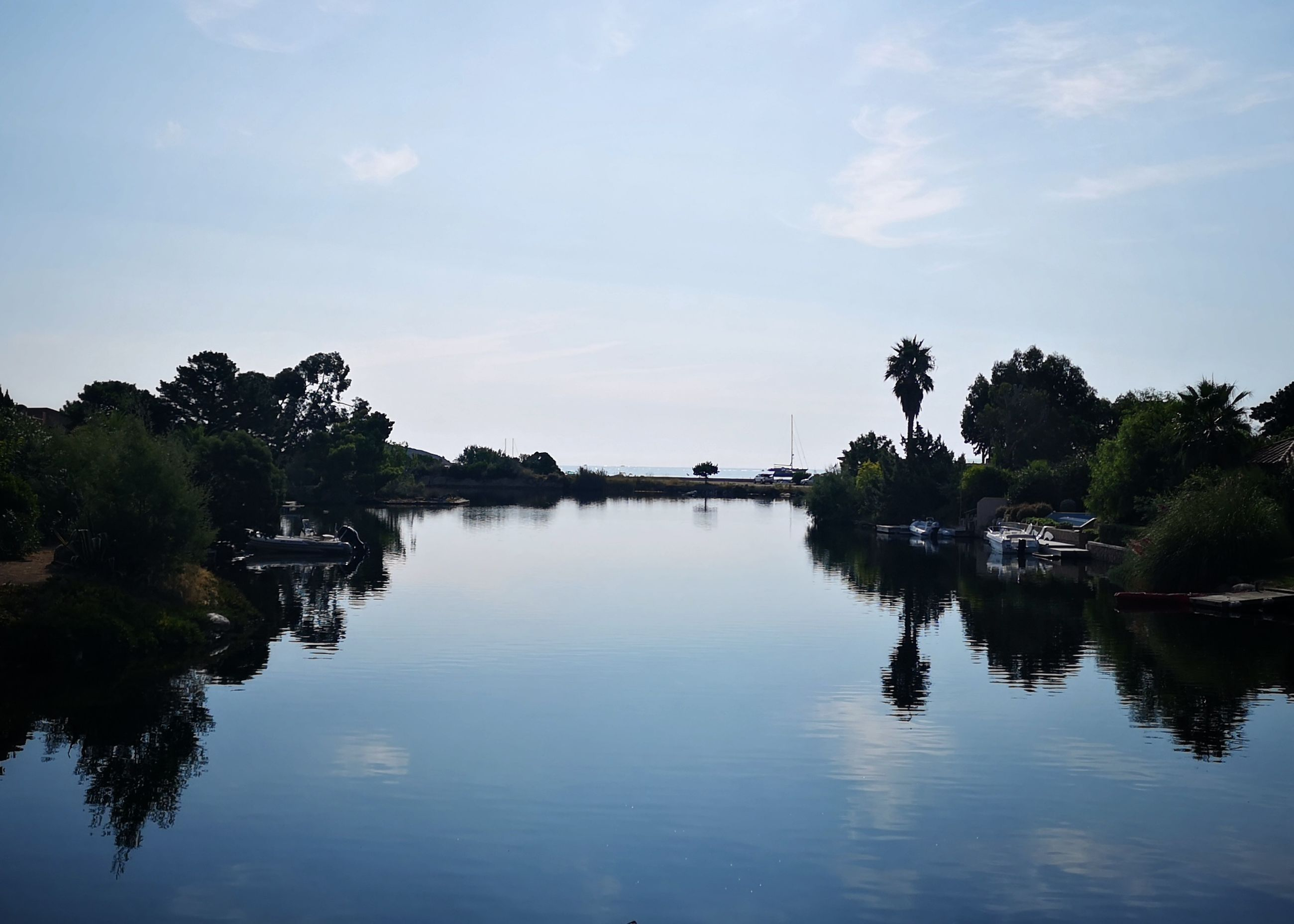 water, tree, sky, reflection, plant, waterfront, nature, scenics - nature, no people, tranquility, cloud - sky, beauty in nature, tranquil scene, lake, architecture, outdoors, built structure, growth