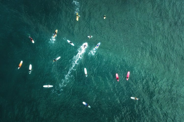Water Sea High Angle View Nautical Vessel Turquoise Colored Transportation Swimming Day Outdoors Nature People Aerial View Directly Above Group Of People Leisure Activity Real People Lifestyles Motion Unrecognizable Person Marine
