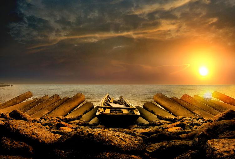 Sunset at Banua patra beach Sky Sea Water Sunset Horizon Over Water Horizon Cloud - Sky Scenics - Nature Beauty In Nature Beach Tranquil Scene Tranquility Land Nature No People Sun Nautical Vessel Idyllic Rock Boat Boat On Beach