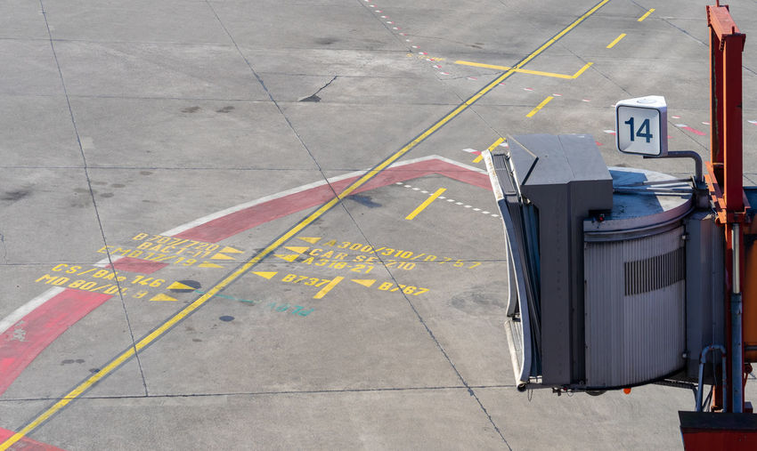 Tiled Floor Garbage Can Road Marking Marking Street Mode Of Transportation Garbage Bin Communication Outdoors Architecture City Yellow Road Symbol Day High Angle View No People Transportation Sign Number Empty Terminal Ramp Business Finance And Industry Business Traveling Travel Airport Public Transportation