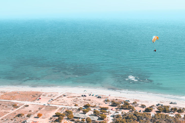 flying along the coast Pine Woodland Beach Aerial View Turquoise Colored Mediterranean  Mediterranean Sea Water Paragliding Sea Beach Adventure Sand Summer Parachute Flying Sky Shore Wave Leisure Calm Horizon Over Water