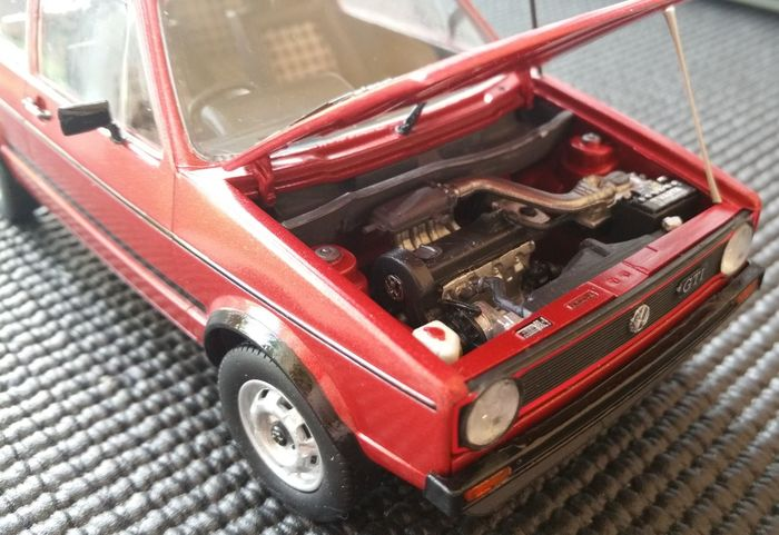 VW Golf Mk1 Driver 1.3 plastic model kit painted in candy red. Airfixmodels Car Close-up Day Golf High Angle View Hobby Mk1 Mk1 Golf Model Kit No People Outdoors Red Transportation Volkswagen Workshop