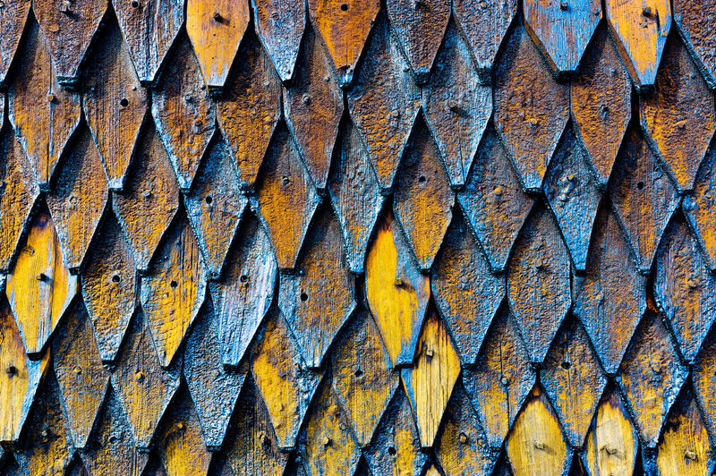 Stavekirke in Norway closeup of the incredible craftsmanship that wend into building this. the walls look like dragon skin Dragonskin Dragon Skin Norway Wood Backgrounds No People Pattern Repetition Stave Church Wall - Building Feature