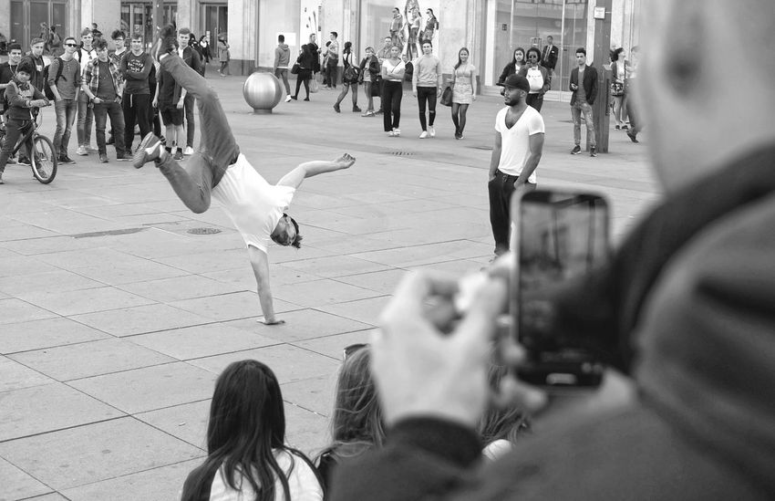 Street artists in early spring scene at Berlin Alexanderplatz Action Alexanderplatz Audience Blackandwhite Camera - Photographic Equipment Candid Crowd Day Editorial  Group Of People Life Men Outdoors People Performance Photographer Strassenfilm Real People Smart Phone Spectator Sport Springtime Streetphotography Summer Women